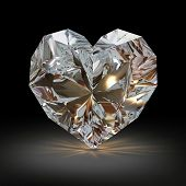 Diamond in the shape of heart on black background.