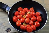 Fried With Seasonings Mini Tomatoes In Pan.