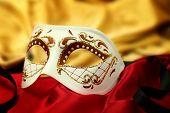 Vintage venetian carnival mask on velvet background