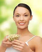 diet and healh concept - healthy woman holding bowl with sprout