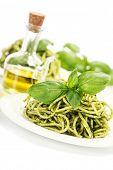 delicious italian pasta with pesto sauce over white
