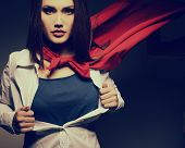 image of superhero  - Young pretty woman opening her shirt like a superhero - JPG