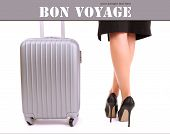 pic of bon voyage  - Businesswoman legs with suitcase isolated on white - JPG