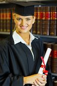 happy female law school graduate in university library