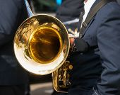 stock photo of trumpets  - Trumpeter of a brass bandwith a bass trumpet - JPG