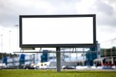 Blank Large billboard against blurred shopping center for your advertisement