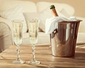 Glasses of champagne with ice bucket in lounge