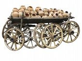 Old Wooden Cart Full Of Clay Pottery And Wheels Isolated Over White