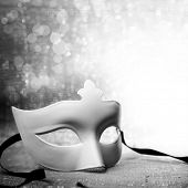 stock photo of parade  - White mask with glittering background - JPG