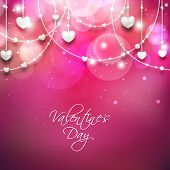 stock photo of friendship day  - Beautiful Happy Valentines Day concept with hanging heart shapes on shiny pink background - JPG