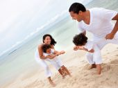 stock photo of rope pulling  - Family at the beach pulling a rope - JPG