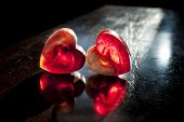 Two Translucent Red Hearts In Sun Beams
