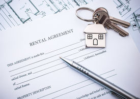 picture of rental agreement  - Rental agreement document with keys and pencil - JPG