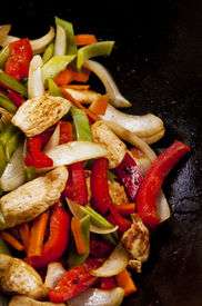 picture of stir fry  - Chicken stir fry with red peppers onion and green beans - JPG