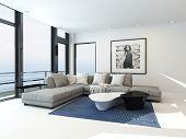 Modern waterfront apartment interior with an upholstered grey corner lounge suite in front of floor-