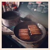 Cooking on camping store with grainy instagram effect