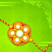 stock photo of dharma  - vector illustration of beautiful rakhi on Raksha Bandhan background - JPG