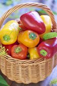 Basket with fresh colorful peppers