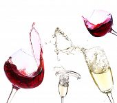Glasses with red wine and champagne, isolated on white