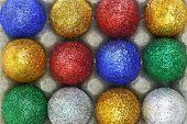 Colorful glitter eggs in carton egg packaging closeup