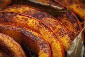 Fresh pumpkin slices roasted with spices close up