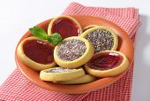 bowl of cookies with jelly fruit and chocolate with coconut