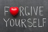 stock photo of forgiveness  - forgive yourself phrase handwritten on school blackboard - JPG