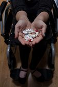 Disabled Woman With Medicines For Depression