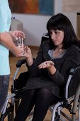 Disabled Woman Taking Medicines