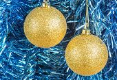 Gold Christmas Balls On The Background Of  Tinsel