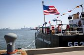 STATEN ISLAND, NY - MAY 25, 2014: The American flag flies from the stern of the USCGC Katherine Walk