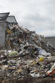 stock photo of landfill  - Truck dumping waste at landfill site - JPG