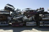 Stacked cars in junkyard