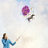 Young woman in casual and zebra flying in sky