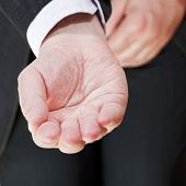 Front View Of Businessman Holding Empty Handful