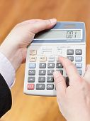 Calculator In Businessman Hands