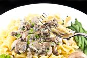 stock photo of crimini mushroom  - Vegetarian mushroom stroganoff with egg noodles and fork - JPG