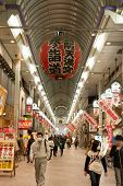 OSAKA, JAPAN - April 16th : People walk at the Osaka Tenmangu shopping arcade, Osaka, Japan on April 16th, 2014.