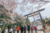 YOSHINO, JAPAN - April 17th : Tourists walking toward Yoshino Mountain, Yoshino, Nara, Japan on Apri