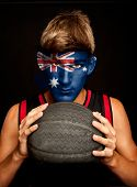 portrait of basketball player with australian flag painted on his face