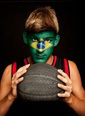 portrait of basketball player with brazilian flag painted on his face