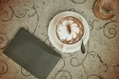Vintage Cup Of Coffee And Book On Table