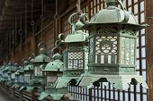 Japanese style bronze lantern hanging up in the shrine of  Kasuga Taisha in Nara, Japan.