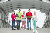 Five Students Standing On A Bridge