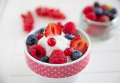 stock photo of frozen  - Frozen Yogurt with fresh berries in a bowl - JPG