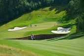 TSELEEVO, MOSCOW REGION, RUSSIA - JULY 24, 2014: Golfers on the golf course in the Tseleevo Golf & P