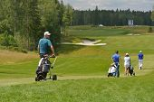 TSELEEVO, MOSCOW REGION, RUSSIA - JULY 24, 2014: Nikolaj Nissen of Denmark and other golfers on the