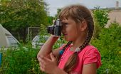 Young Girl With Camera