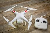 FORT COLLINS, CO, USA, JULY 24, 2014:  Radio controlled DJI Phantom quadcopter drone on a wooden dec