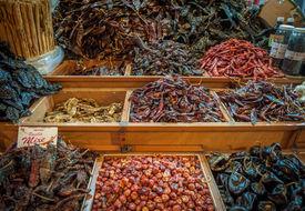picture of pasilla chili  - Choice of dried chili in Oaxaca market Mexico  - JPG